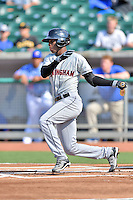 Birmingham Barons shortstop Tim Anderson (7) swings at a pitch during a game against the Tennessee Smokies on August 2, 2015 in Kodak, Tennessee. The Smokies defeated the Barons 5-2. (Tony Farlow/Four Seam Images)