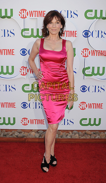 Marilu Henner.CBS, CW and Showtime Summer 2011 TCA Party held at The Pagoda, Beverly Hills, California, USA..August 3rd, 2011.full length dress hand on hip pink silk satin.CAP/ROT/TM.©Tony Michaels/Roth Stock/Capital Pictures