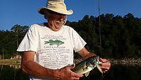 NWA Democrat-Gazette/FLIP PUTTHOFF <br /> Dwayne Culmer's shirt shows how much gear can be accumulated when one enjoys fishing or other outdoor pursuits.