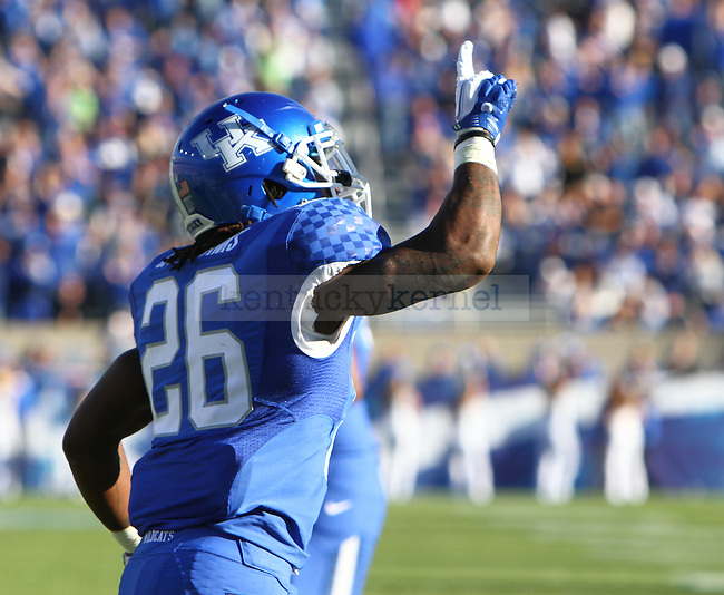 UK running back CoShik Williams points up to the sky after scoring a touchdown during the first half of the UK's home game against Ole Miss at Commonwealth in Lexington, Ky., Nov. 5, 2011. Photo by Brandon Goodwin | Staff