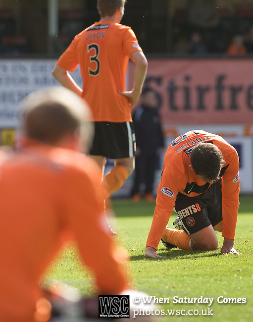Dundee United 0 Dunfermline Athletic 1, 20/08/2011. Tannadice Park, Scottish Premier League. Dundee United players slump to the floor at the final whistle of their team's Scottish Premier League match at Tannadice Park, Dundee against visitors Dunfermline Athletic. The visitors won the game by one goal to nil, watched by a crowd of 6,527. Dundee United's stadium was situated on the same street as their city rival Dundee, whose Dens Park ground was visible in the background.