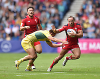Wales's William Harries evades the tackle of Australia's Greg Jeloudev<br /> <br /> Australia Vs Wales - Men's quarter-final<br /> <br /> Photographer Chris Vaughan/CameraSport<br /> <br /> 20th Commonwealth Games - Day 4 - Sunday 27th July 2014 - Rugby Sevens - Ibrox Stadium - Glasgow - UK<br /> <br /> © CameraSport - 43 Linden Ave. Countesthorpe. Leicester. England. LE8 5PG - Tel: +44 (0) 116 277 4147 - admin@camerasport.com - www.camerasport.com