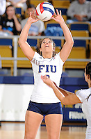 13 November 2010:  FIU's Natalia Valentin (9) sets the ball in the second set as the FIU Golden Panthers defeated the South Alabama Jaguars, 3-0 (25-12, 25-12, 25-20), at U.S Century Bank Arena in Miami, Florida.