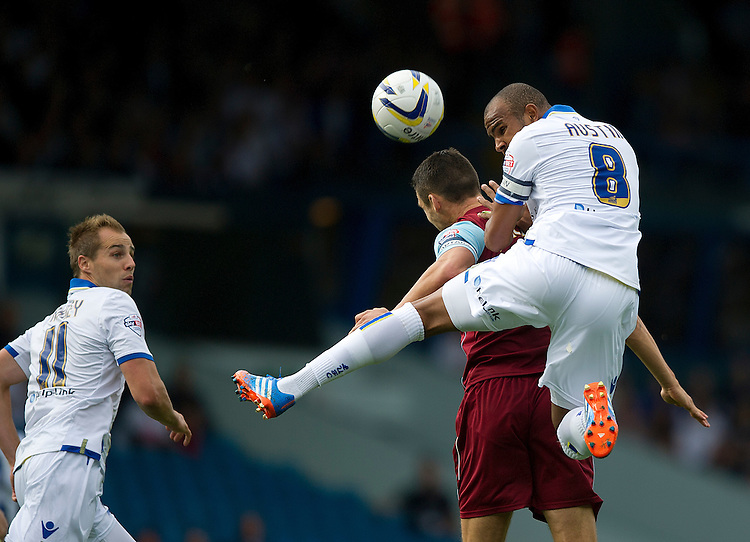 Leeds United's Rodolph Austin out jumps Burnley's Jason Shackell to clear the ball <br /> <br /> Photo by Stephen White/CameraSport<br /> <br /> Football - The Football League Sky Bet Championship - Leeds United v Burnley - Saturday 21st September 2013 - Elland Road - Leeds<br /> <br /> &copy; CameraSport - 43 Linden Ave. Countesthorpe. Leicester. England. LE8 5PG - Tel: +44 (0) 116 277 4147 - admin@camerasport.com - www.camerasport.com