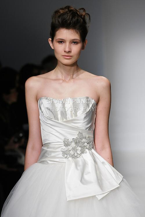 Model walks runway in a Lourdes wedding dresses by Amsale Aberra, for the Kenneth Pool Spring 2012 Bridal runway show.