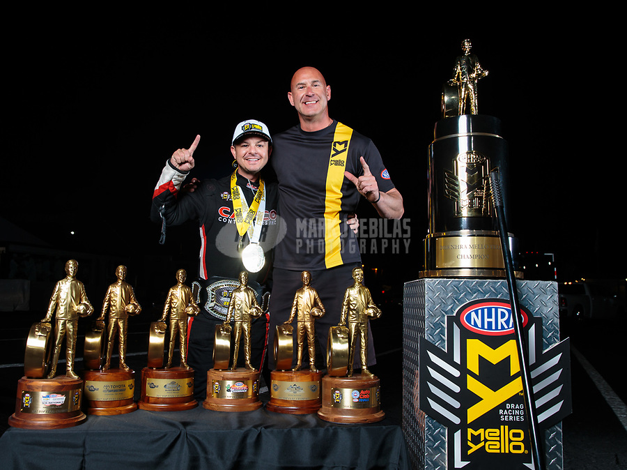 Nov 11, 2018; Pomona, CA, USA; NHRA top fuel driver Steve Torrence poses for a portrait with Coca Cola/Mello Yello official Mike Adams as he celebrates after winning the Auto Club Finals at Auto Club Raceway. Torrence swept all six of the countdown to the championship races to clinch the world championship. Mandatory Credit: Mark J. Rebilas-USA TODAY Sports