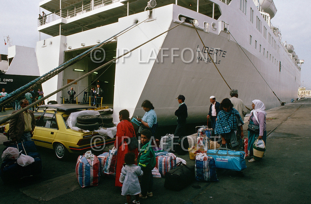 May 27, 1989, Marseilles, France --- Muslim immigration in the port city of Marseille. Algerian passengers disembark Liberte ship. --- Image by © JP Laffont