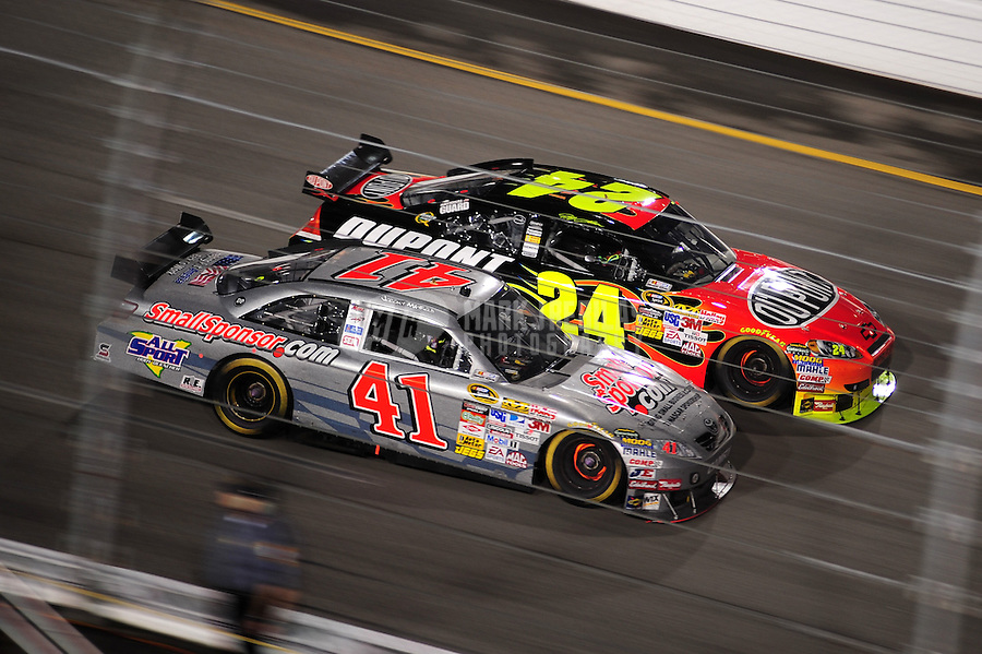 May 2, 2009; Richmond, VA, USA; NASCAR Sprint Cup Series driver Jeremy Mayfield (41) races alongside Jeff Gordon (24) during the Russ Friedman 400 at the Richmond International Raceway. Mandatory Credit: Mark J. Rebilas-