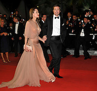 ANGELINA JOLIE &amp; BRAD PITT <br /> Leaving the premiere of &quot;Inglorious Basterds&quot;  at the Grand Theatre Lumiere  during the 62nd Cannes International Film Festival, Cannes, France, <br /> May 20th 2009.<br /> full length departures black suit tux tuxedo Tom Ford long beige peach silk dress maxi draped v-neck clutch bag satin shoes open toe cream couple leaving walking bow tie white shirt leg thigh slit split side profile sheer holding hands <br /> CAP/PL<br /> &copy;Phil Loftus/Capital Pictures /MediaPunch ***NORTH AND SOUTH AMERICAS ONLY***