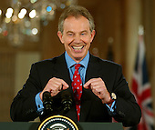 Washington, D.C. - May 25, 2006 -- Prime Minister Tony Blair of the United Kingdom and United States President George W. Bush hold a joint press conference in the East Room of the White House in Washington, D.C. on May 25, 2006.  Blair was at the White House for talks on a wide array of issues with the President..Credit: Ron Sachs / CNP