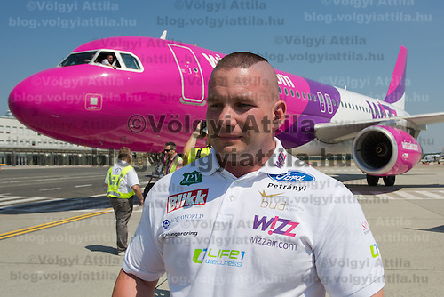 Zsolt Sinka breaks record in pulling an Airbus A320 airplane weighing about 50 tons in 52 seconds on a distance of 39,2 meters with his teeth in Budapest, Hungary on June 20, 2013. ATTILA VOLGYI
