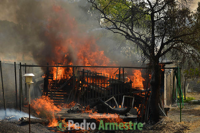 Flames blazed from a property at the site of a wildfire in Tres Cantos, north of Madrid on August 22, 2013. © Pedro ARMESTRE.