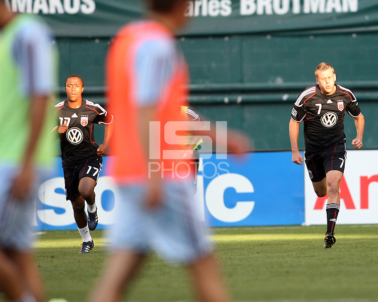 Boyzzz Khumalo #17 and Adam Cristman #7 of D.C. United warm up during an MLS match against the Colorado Rapids on May 15 2010, at RFK Stadium in Washington D.C. Colorado won 1-0.