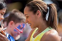 Jessica ENNIS HILL of GBR (Women's long Jump) signs autographs during the Sainsbury's Anniversary Games, Athletics event at the Olympic Park, London, England on 25 July 2015. Photo by Andy Rowland.