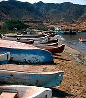 Beached fishing boats on the shore. Santa Marta, Colombia, Caribbean. 1976