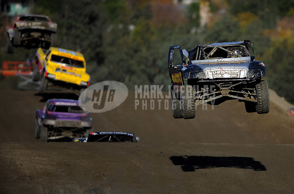 Dec. 19, 2009; Lake Elsinore, CA, USA; LOORRS unlimited two driver Greg Adler (right) takes a jump after crashing during the Lucas Oil Challenge Cup at the Lake Elsinore Motorsports Complex. Mandatory Credit: Mark J. Rebilas-US PRESSWIRE