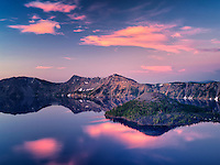 Crater Lake with Wizard Island at sunrise . Crater Lake National Park, Oregon