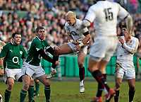 Shane Geraghty leaps into the air to claim the ball. International match between the England Saxons and Ireland A on January 31, 2010 at the Recreation Ground in Bath, England. [Mandatory Credit: Patrick Khachfe/Onside Images]