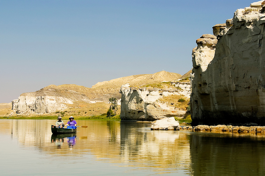 Two boaters paddle the White Cliffs of the Missouri River in central Montana.