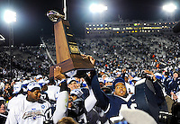 Penn State QB Daryll Clark (17) hoists the BIG TEN Conference Championship Trophy.