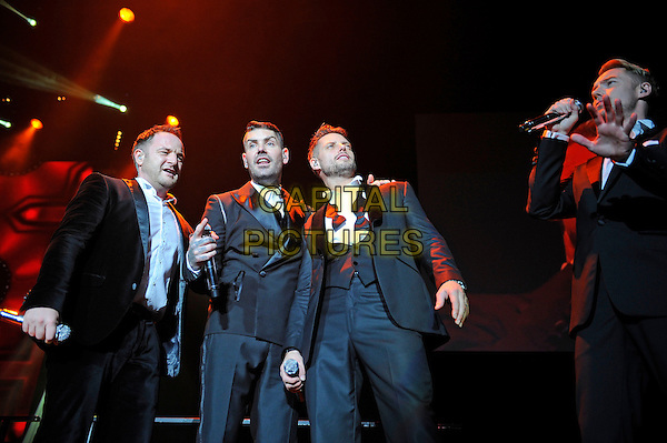 LONDON, ENGLAND - December 21: Mikey Graham, Shane Lynch, Keith Duffy and Ronan Keating of Boyzone performs in concert at Wembley Arena on December 21st, 2013 in London, England. UK.<br /> CAP/MAR<br /> &copy; Martin Harris/Capital Pictures