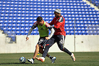 Matt Kassel (15) and Thierry Henry (14) of the New York Red Bulls battle for the ball during practice on Media Day at Red Bull Arena in Harrison, NJ, on March 15, 2011.