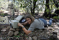 Horses come to a water hole at the Wild Horse Sanctuary where there are 300 horses on 5,000 acres that have been saved.  Melissa Farlow sets up camera trap.