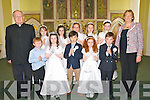 Pupils from Lisselton NS who received their First Holy Communion in St Teresas Church, Ballydonoghue, on Saturday last. Front l-r: Padraig O'Connor, Rachael Houlihan, William Hazelwood, Sarah Moriarty and Thomas Molyneaux. Back l-r: Fr John Lawlor, Amy Lynch, Ava Stack, Shauna Barry, Aoife Donegan, Katie Gill-Dunworth and teacher Regina Walsh.