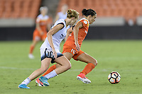 Houston, TX - Saturday July 08, 2017: Carli Lloyd races up the field with Allie Long in pursuit during a regular season National Women's Soccer League (NWSL) match between the Houston Dash and the Portland Thorns FC at BBVA Compass Stadium.