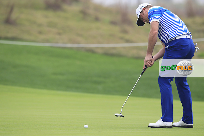 Jamie Donaldson (WAL) putts on the 5th green during Saturay's Round 3 of the 2014 BMW Masters held at Lake Malaren, Shanghai, China. 1st November 2014.<br /> Picture: Eoin Clarke www.golffile.ie