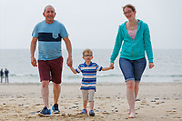 Pictured: William Mosley (C) with his mother Charlotte Heritage (R) and her partner Andy Faville (L). Saturday 09 June 2018<br /> Re: Four year old William Mosley who enjoys collecting plastic litter.
