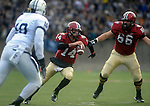 (Cambridge Ma 11/22/14) Harvard quarterback, 14, Conner Hempel, center, find a hole for a short run in the first half, Harvard 66, Michael Mancinelli,  Yale 10, Victor Egu  as Harvard defeated Yale 31-24. Jim Michaud Photo