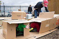 NWA Democrat-Gazette/CHARLIE KAIJO Melanie Sisson of Vilona (right) creates a box fort with her children (from left) Mason Sisson, 4 and Brody Sisson, 6, Monday, March 19, 2018 at the Amazeum in Bentonville. <br /><br />The adventure playground or &quot;junk playground&quot; allows kids to create their own play space from found materials. The idea is based on a theory of play in existence in Europe since after World War II. People noticed children were playing more in spaces that were bombed out and had loose parts they could interact with rather than the adult designed playgrounds said Jess Graff of Portland, Ore. who brought the idea to Amazeum.<br /><br />&quot;Kids can build a lot of different skills, independence, confidence, teamwork,&quot; Graff said. &quot;As adults we can remember a time as a child we were having a fantastic time. Often those are experiences where there&acirc;&euro;&trade;s a little bit of risk involved in the play.&quot;