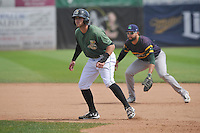 Clinton LumberKings Dalton Kelly (7) leads off first base during the Midwest League game against the Beloit Snappers at Ashford University Field on June 12, 2016 in Clinton, Iowa.  The LumberKings won 1-0.  (Dennis Hubbard/Four Seam Images)