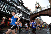 09 SEP 2011 - CHESTER, GBR - Competitors run under the Eastgate Clock during the MBNA Chester Marathon .(PHOTO (C) NIGEL FARROW)