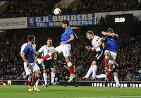 Emilson Cribari heads clear in the Rangers v Queen of the South Quarter Final match in the Ramsdens Cup played at Ibrox Stadium, Glasgow on 18.9.12.