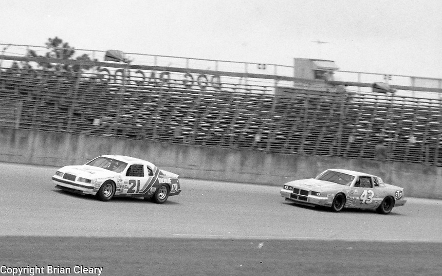 Buddy Baker 21 Richard Petty 43 action Firecracker 400 at Daytona International Speedway in Daytona Beach, FL on July 4, 1983. (Photo by Brian Cleary/www.bcpix.com)
