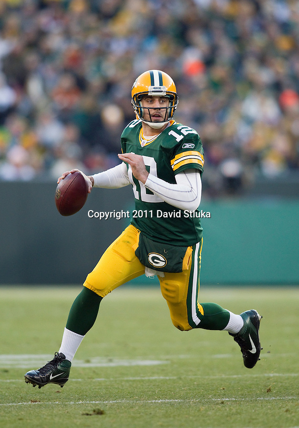 Green Bay Packers quarterback Aaron Rodgers (12) looks for a receiver during a Week 14 NFL football game against the Oakland Raiders on December 11, 2011 in Green Bay, Wisconsin. The Packers won 46-16. (AP Photo/David Stluka)