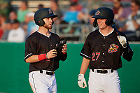 Batavia Muckdogs J.D. Orr (22) and Troy Johnston (27) during a NY-Penn League game against the Lowell Spinners on July 10, 2019 at Dwyer Stadium in Batavia, New York.  Batavia defeated Lowell 8-6.  (Mike Janes/Four Seam Images)