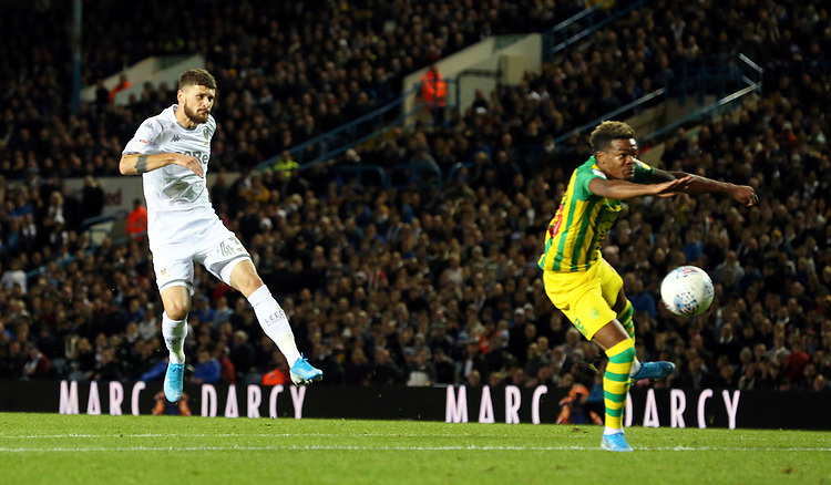 Leeds United's Mateusz Klich shoots despite the attentions of West Bromwich Albion's Grady Diangana<br /> <br /> Photographer Rich Linley/CameraSport<br /> <br /> The EFL Sky Bet Championship - Tuesday 1st October 2019  - Leeds United v West Bromwich Albion - Elland Road - Leeds<br /> <br /> World Copyright © 2019 CameraSport. All rights reserved. 43 Linden Ave. Countesthorpe. Leicester. England. LE8 5PG - Tel: +44 (0) 116 277 4147 - admin@camerasport.com - www.camerasport.com