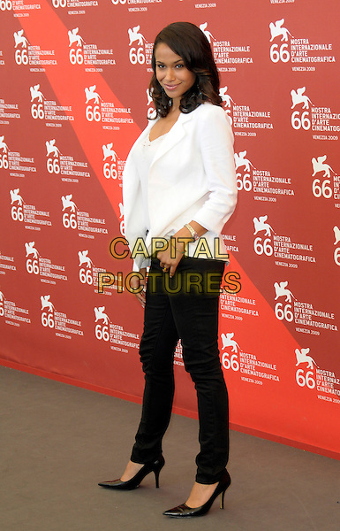 "SHANNON KANE .at the Photocall for ""Brooklyns Finest"" at the Palazzo del Casino during 66th Venice International Film Festival, Lido, Venice, Italy,  8th September 2009..full length black trousers pointy shoes heels white jacket side skinny jeans .CAP/RD .©Richard Dean/Capital Pictures"