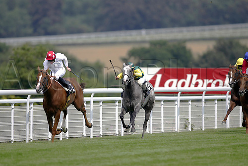 29 July 2004: Jockey RYAN MOORE drives PETER PAUL RUBENS to victory over Compton's Eleven in the Albert Stakes at Goodwood Photo: Glyn Kirk/Action Plus...horse racing 040729 flat horses