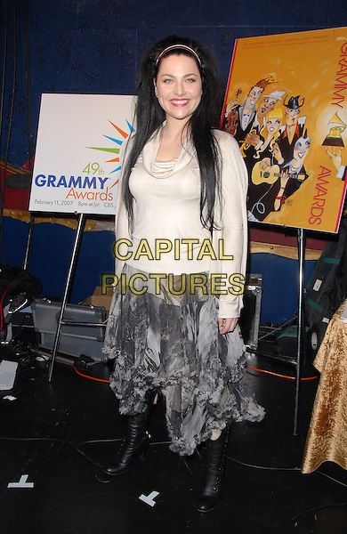AMY LEE - EVANESCENCE.49th Annual GRAMMY Awards Nominations Announcement in Hollywood, California, USA. .December 7th, 2006.full length black boots grey gray dress cream beige top cowl neck cowel .CAP/DVS.©Debbie VanStory/Capital Pictures