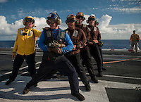 111207-N-DR144-176 PACIFIC OCEAN (Dec. 7, 2011) Aviation Boatswain's Mate (Handling) 3rd Class Alexsis Labrake leads a hose team during flight deck firefighting drills aboard Nimitz-class aircraft carrier USS Carl Vinson (CVN 70). Carl Vinson and Carrier Air Wing (CVW) 17 are currently underway on a Western Pacific deployment.  (U.S. Navy photo by Mass Communication Specialist 2nd Class James R. Evans/Released)