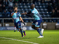 Adebayo Akinfenwa of Wycombe Wanderers celebrates his goal with Scott Kashket during the Sky Bet League 2 match between Wycombe Wanderers and Luton Town at Adams Park, High Wycombe, England on the 21st January 2017. Photo by Liam McAvoy.