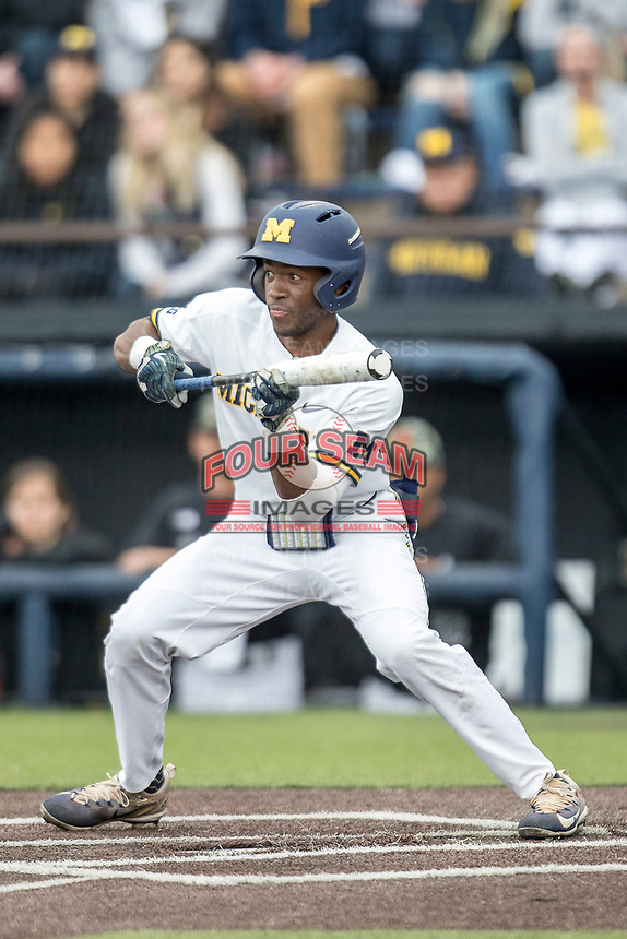 Michigan Wolverines outfielder Christian Bullock (5) squares to bunt against the Maryland Terrapins on April 13, 2018 in a Big Ten NCAA baseball game at Ray Fisher Stadium in Ann Arbor, Michigan. Michigan defeated Maryland 10-4. (Andrew Woolley/Four Seam Images)