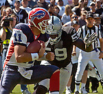 Oakland Raiders linebacker DeLawrence Grant (59) sacks Buffalo Bills quarterback Drew Bledsoe (11) on Sunday, September 19, 2004, in Oakland, California. The Raiders defeated the Bills 13-10.