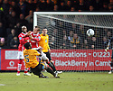 Brian Saah of Cambridge United tackles Dean Keates of Wrexham and is sent off during the Blue Square Bet Premier match between Cambridge United and Wrexham at the Abbey Stadium, Cambridge on 22nd January, 2011 .© Kevin Coleman 2011