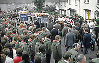 Funeral of Tommy Herron, former vice-chairman of the UDA, who was assassinated on 16th September 1973 moves off from his East Belfast home. There were four hearses to cope with the large number of floral tributes. Herron received a paramilitary funeral. The funeral service was conducted by Rev. Ian Paisley. It was attended by 25,000 mourners. He was buried at Roselawn Cemetery as a piper played Amazing Grace. 197309190590c.<br /> <br /> Copyright Image from Victor Patterson, 54 Dorchester Park, Belfast, UK, BT9 6RJ<br /> <br /> t1: +44 28 9066 1296 (from Rep of Ireland 048 9066 1296)<br /> t2: +44 28 9002 2446 (from Rep of Ireland 048 9002 2446)<br /> m: +44 7802 353836<br /> <br /> e1: victorpatterson@me.com<br /> e2: victorpatterson@gmail.com<br /> <br /> The use of my copyright images is subject to my Terms & Conditions.<br /> <br /> It is IMPORTANT that you familiarise yourself with them. They are available on my website at www.victorpatterson.com.<br /> <br /> None of my copyright images may be used on a website or on television unless they are visibly watermarked, i.e. © Victor Patterson within the body of the visible image. The metadata of images used on the Internet must not be removed.<br /> <br /> Copyright acknowledgment of my images is a condition of use.<br /> <br /> Failure to observe the above conditions will incur a penalty of at least 100% of the agreed fee. <br /> <br /> Web use (maximum size - 400 kb) is extra at currently recommended NUJ rates.