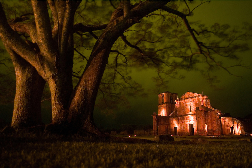 A theatrical night light and sound show illuminates the crumbling façade of the church at the ruins of the São Miguel (Sao with a tilde on the a) mission in southern Brazil. Scores of Jesuit missions in the area where Paraguay, Argentina and Brazil meet were built in the 17th century and abandoned when the Jesuits were expelled in the 18th century. Ruins of some of these missions still haunt hilltops in the region. (Kevin Moloney for the New York Times)